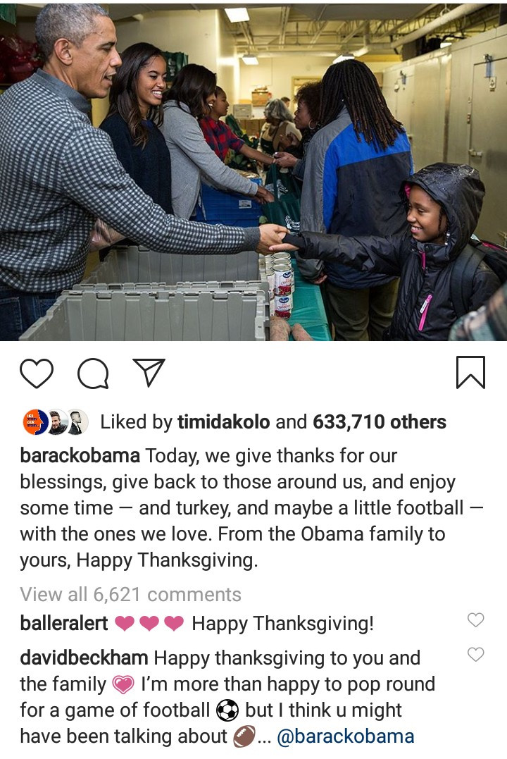 Barack Obama and his family pictured distributing food to people to celebrate Thanksgiving