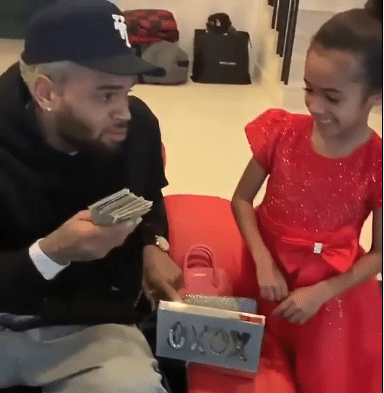 Chris Brown gifted his daughter a stack of cash for Christmas (video)