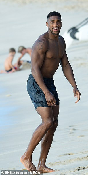 Anthony Joshua shows off his muscular physique during beach day in Barbados (Photos)