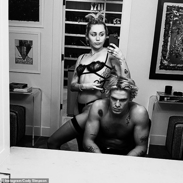 Miley Cyrus dresses in black lingerie to give boyfriend Cody Simpson a haircut (photos)