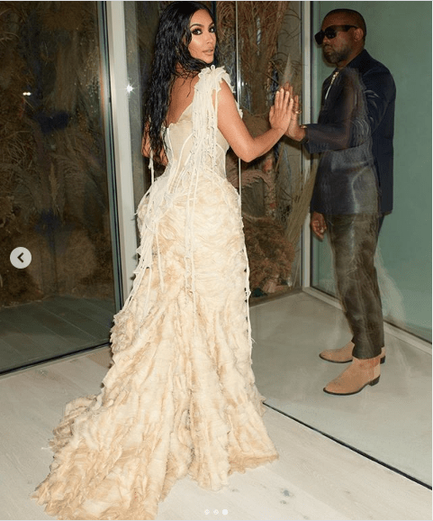 Kim Kardashian stuns in extravagant gown as she attends the Oscars after-party with husband Kanye West (Photos)