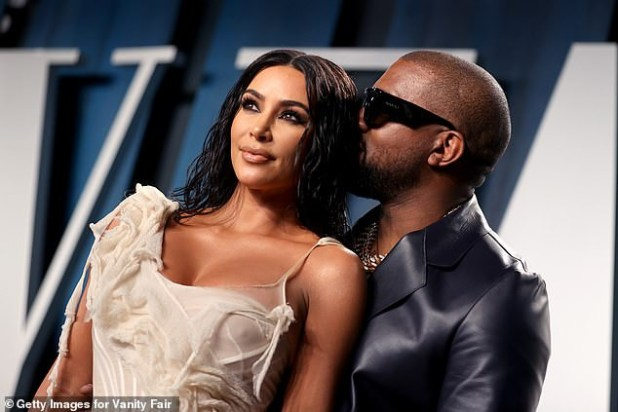 Kim Kardashian locks lips with husband Kanye West at star-studded Vanity Fair Oscars party (Photos)