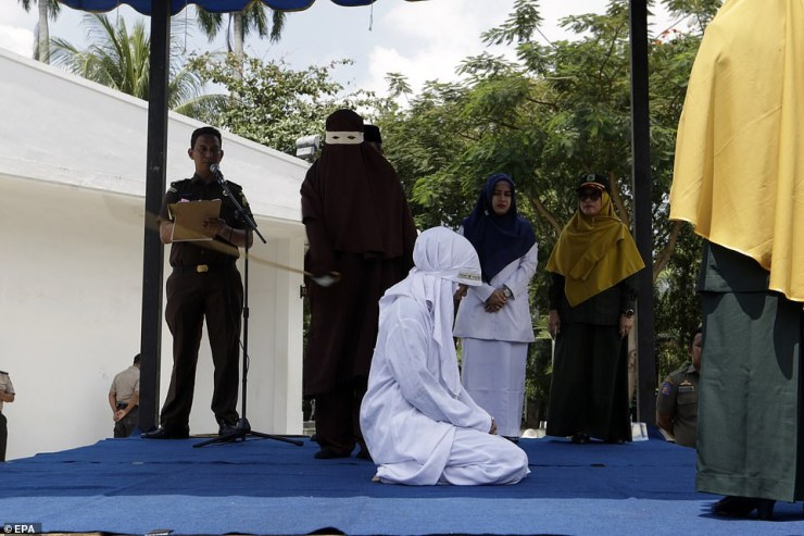 Image result for Photos Of Indonesian Woman Flogged Mercilessly In Public For Having Sex Outside Marriage