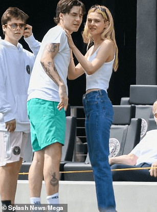 David and Victoria Beckham pack on the PDA during a family outing with their kids and their girlfriends (photos)