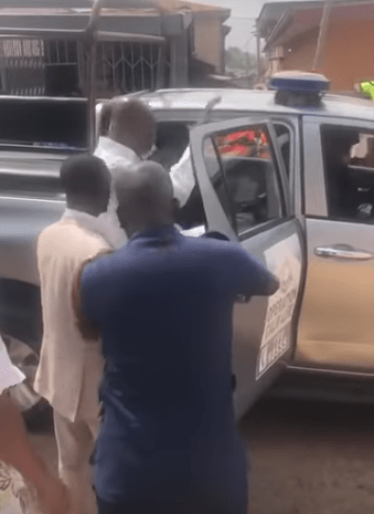 Moment police storm packed church to arrest the pastor for conducting service despite government order banning public gatherings (video)