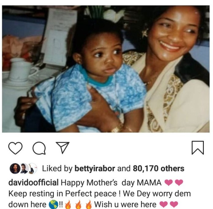 Davido shares photo of his mother carrying him as a baby to wish her a Happy Mothers