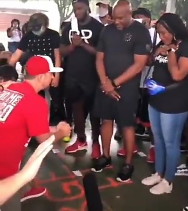 Moment white people knelt before black community to ask for forgiveness for years of racism