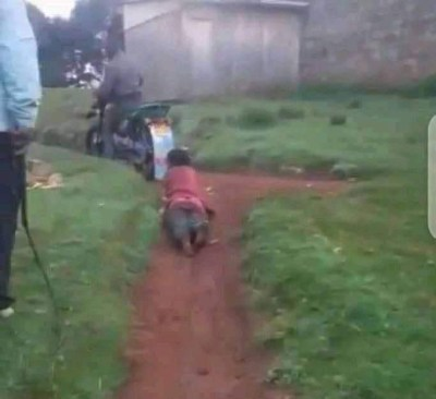 Policeman filmed dragging a woman tied to his motorcycle on a dirt path (video)
