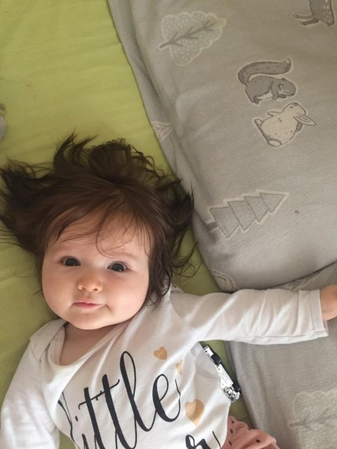 Baby born with head of thick hair that you could see it on the scan (photos)