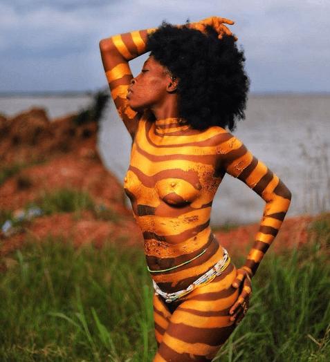Tribal mark model, Adetutu OJ leaves little to the imagination as she goes naked for a shoot