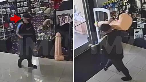 Man caught on camera stealing massive dildo from a sex shop in broad daylight (video)