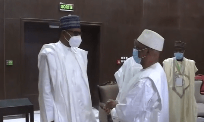 President Buhari wears a face mask for the first time publicly as he arrives Mali for the ECOWAS peace mission (photos)