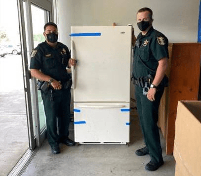 Police deliver new fridge to a woman after she called 911 to complain that her refrigerator broke down