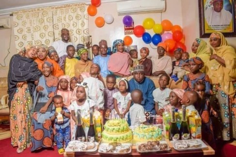 Lovely photo of Nigerian lawmaker, Alhassan Ado-Doguwa, with his four wives and 27 children