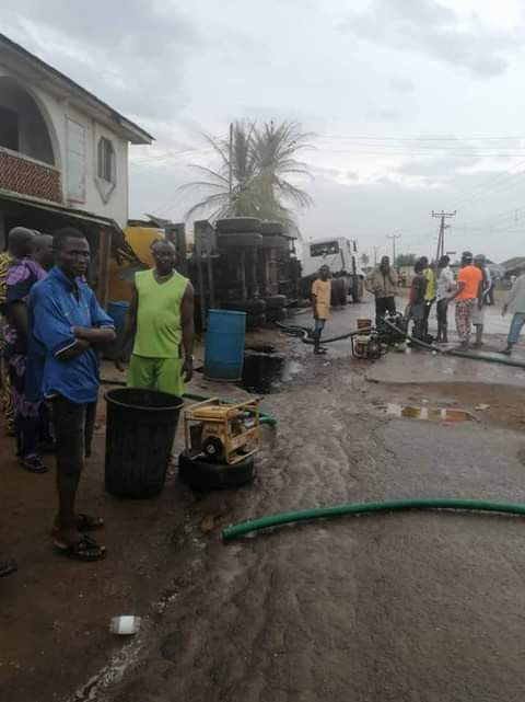 Panic as residents scoop fuel from fallen tanker in Lagos