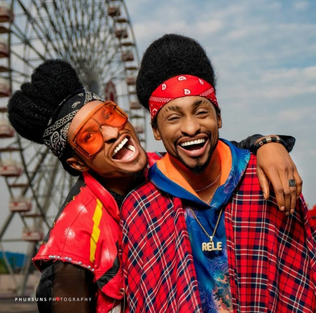 """""""Time to start questioning our parents"""" Denrele says as he meets and poses with his doppelganger (photos)"""