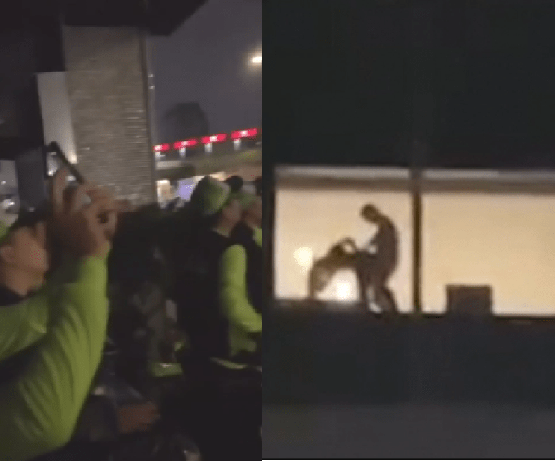 Shocking moment couple were spotted having sex in hotel window in full view of religious festival goers (video)