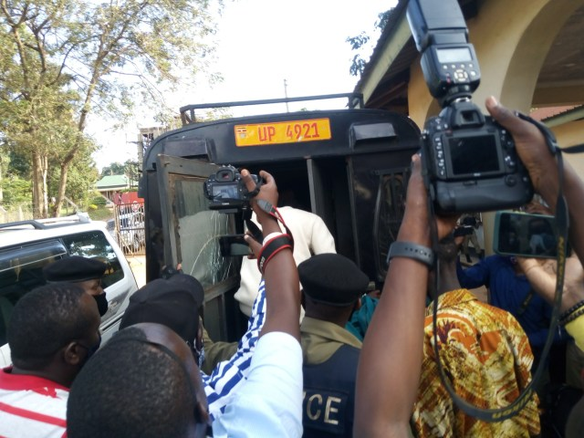 Photos of Nigerian singer Omah Lay in handcuffs and being taken to prison in Uganda