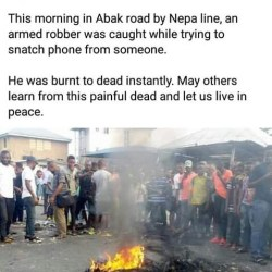 Graphic: Angry mob sets thief ablaze for snatching mobile phone; puts his burnt remains on the sidewalk(photos).