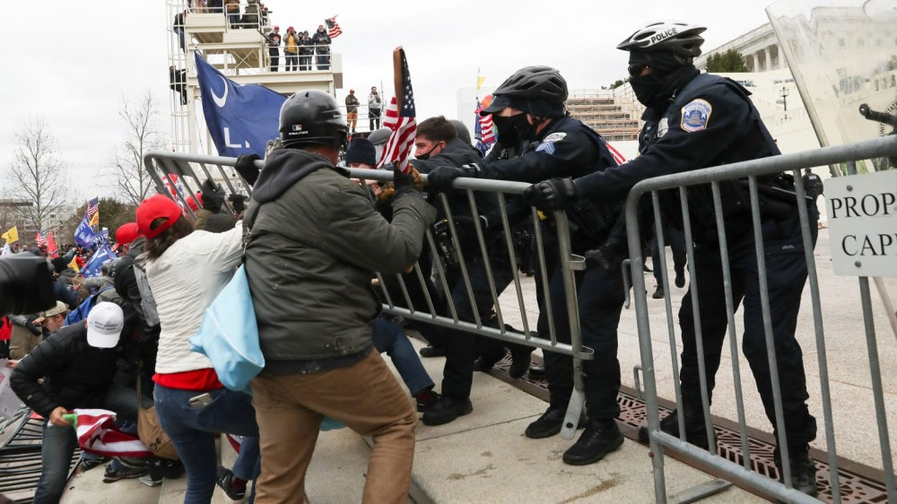 Donald Trump supporters clash with police as they attempt to gain access to the U.S. Capitol building ahead of Joe Biden