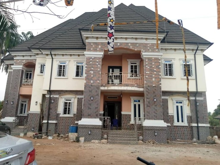 Nigerian native doctor shows off the mansion he built after answering the