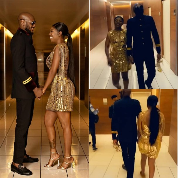 2face Idibia holds wife, Annie Idibia's shoes for her as they left the Headies award ceremony (video)