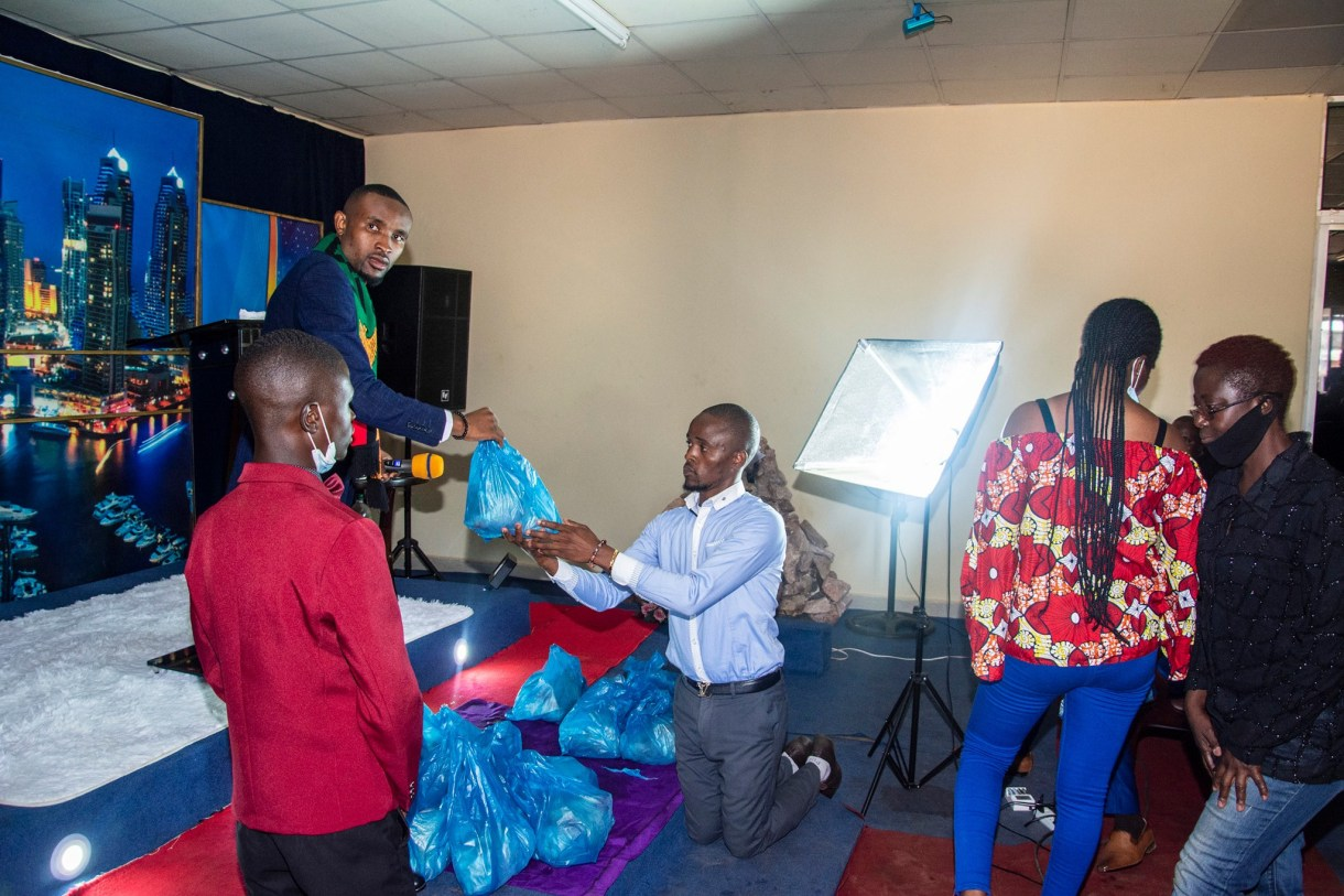 Church members kneel down to welcome their pastor in Zambia