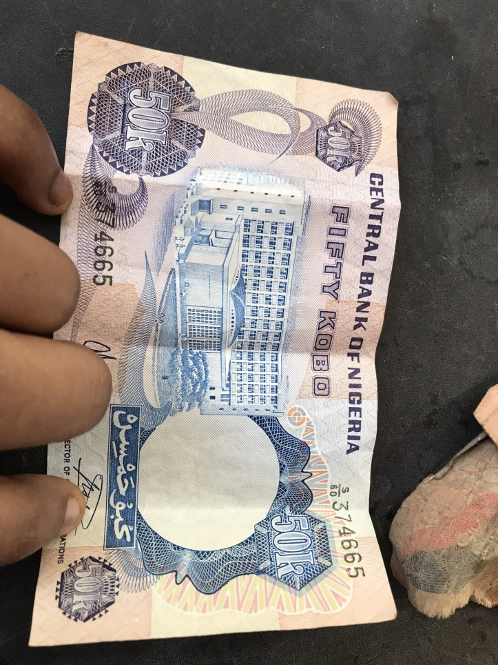 Nigerians react after lady on Twitter shared photos of old Biafran notes she found in her father