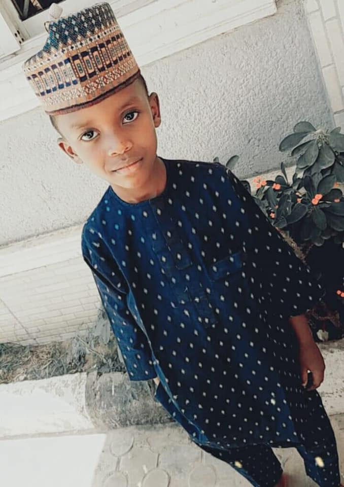 One of the suspects who kidnapped and killed 6-year-old Kaduna boy pictured spending quality time with his own children