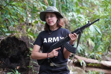 Former beauty queen takes up arms to fight against Myanmar's military junta as citizens begin revolution (photos)