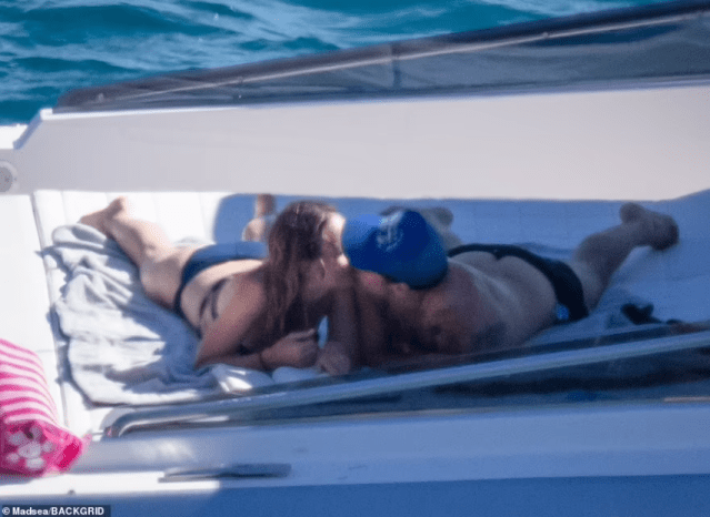 Harry Styles, 27, and girlfriend Olivia Wilde, 37, passionately kiss while enjoying a romantic day onboard a yacht in Tuscany