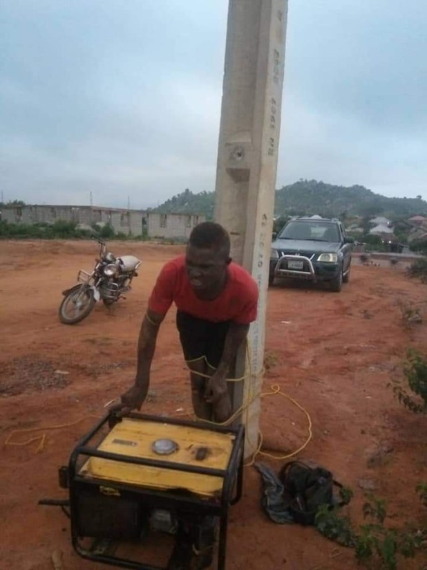 Suspected thief caught and tied to electric pole for allegedly stealing generator in Abuja (photos)