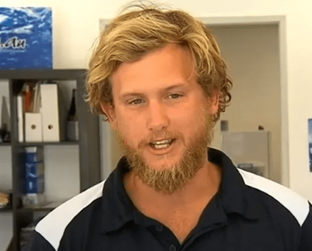 Man who calls himself a 'shark rider' is mauled seconds after jumping on back of shark