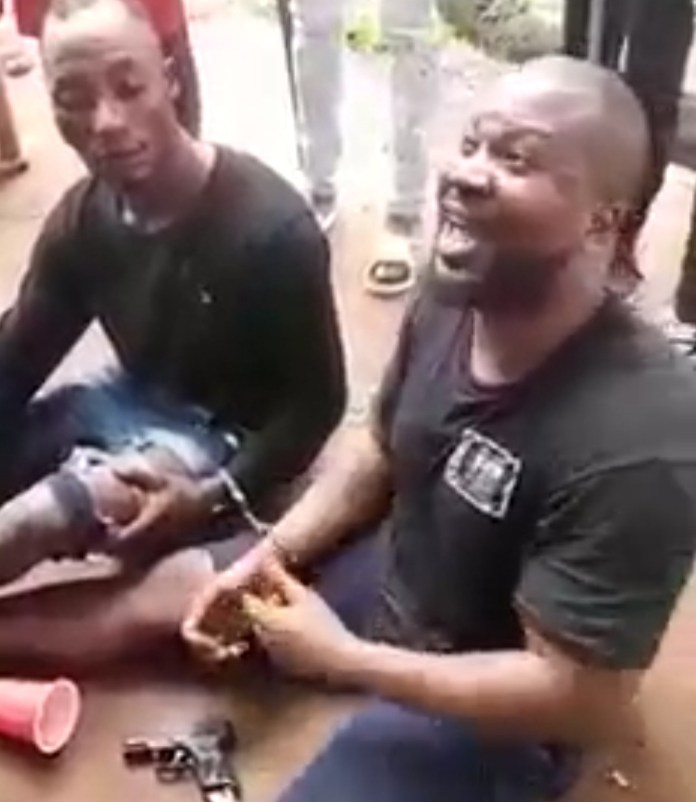 US-based man arrested in Nigeria and paraded after a gun was found on his person (video)