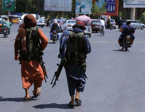 Smiling Taliban militants declare