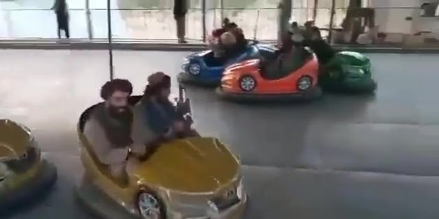 Armed Taliban fighters ride dodgems in amusement park as they enjoy spoils of war after taking over Afghanistan (Photos/video)