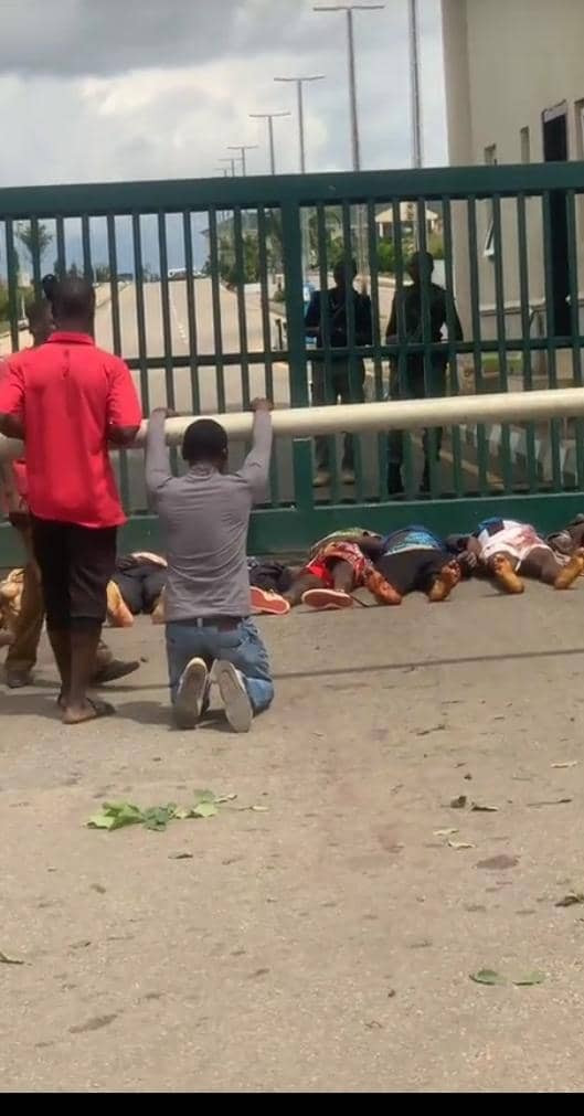 Plateau Attack: Two mobile policemen unable to hold back tears as bodies of victims are displayed at Government House (photos)
