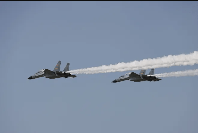 China flies 10 fighter jets into Taiwan air space sparking WW3 fears after sending planes over 15 times in two weeks