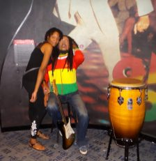 Posing with Bob Marley - Alexis Chateau - Wax Museum