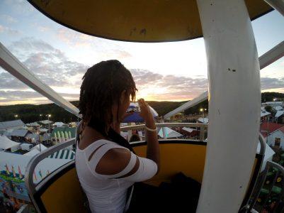 alexis chateau ferris wheel sunset jamaican woman dreads
