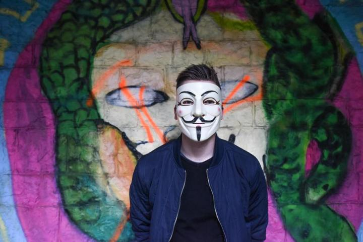 man mask graffiti wall