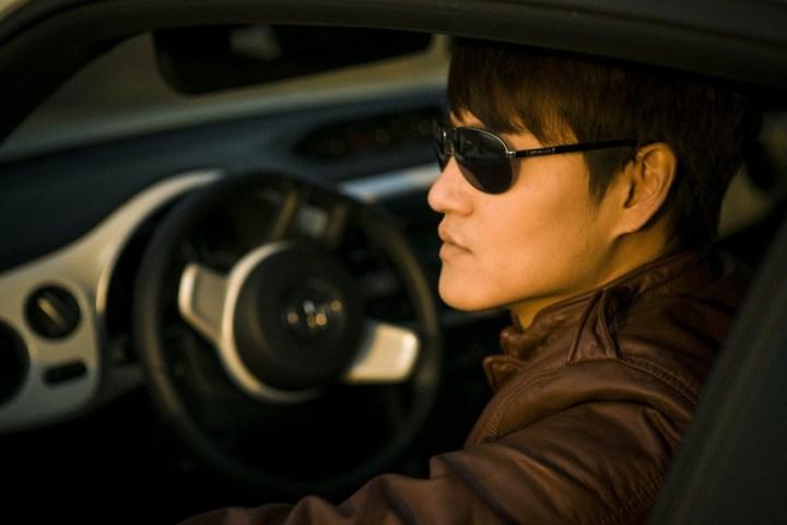 asian male model car luxury wealth success