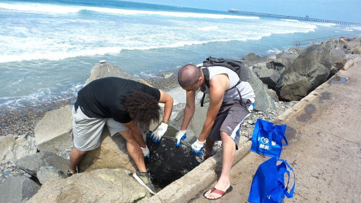 Tristan O'Bryan and Ericson Quero Morning After the Mess Beach Cleanup Oceanside Pier.jpg