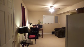 Furnished Room from Bathroom Door