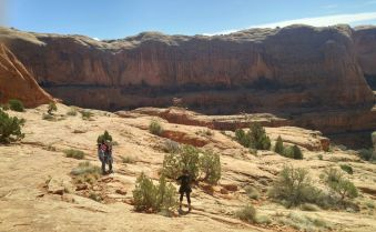 36.5 Alexis Chateau Taking Picture of Family Corona Arches Hiking Trail Utah