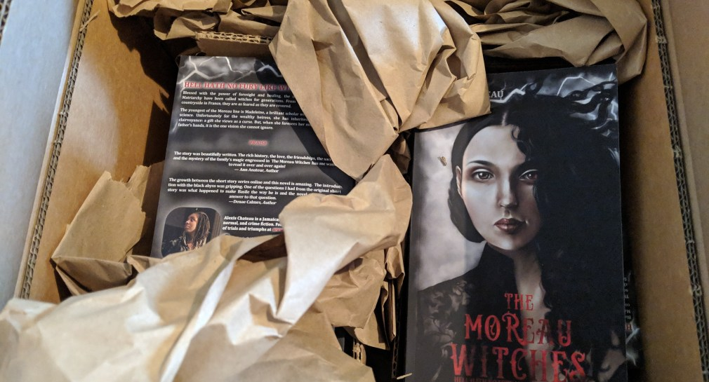Paperback copies of The Moreau Witches