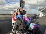 this is me and my family at Heathrow airport before we left
