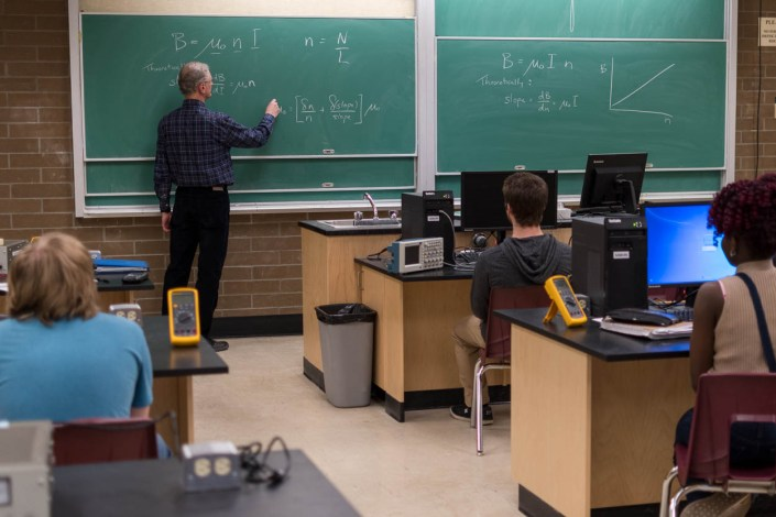 A classroom of engineering students watch their lecturer.