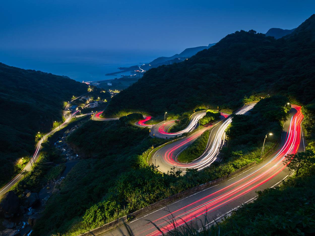 Cars drive down Taiwan's Jinshui road near Jiufen
