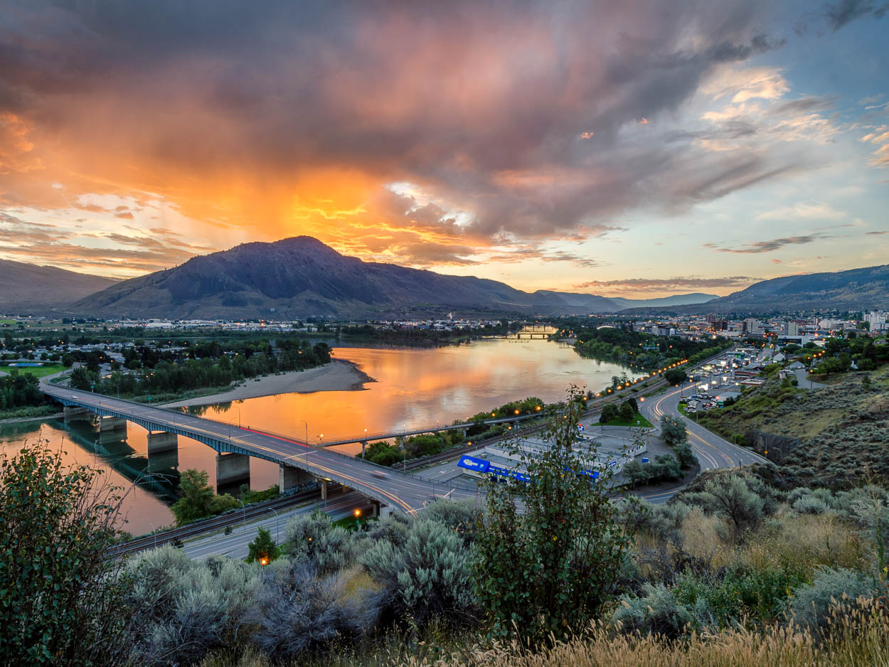 Skies above Kamloops and the Thompson River are lit by the sunrise.